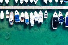 Aerial View Of Boats And Ski Jets In The Sea. Boats And Ski Jets In The Ocean.