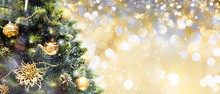 Christmas Tree Decorated With Golden Balls Toys On A Blurred, Gold Sparkling And Fabulous Fairy Background With Beautiful Bokeh, Copy Space.