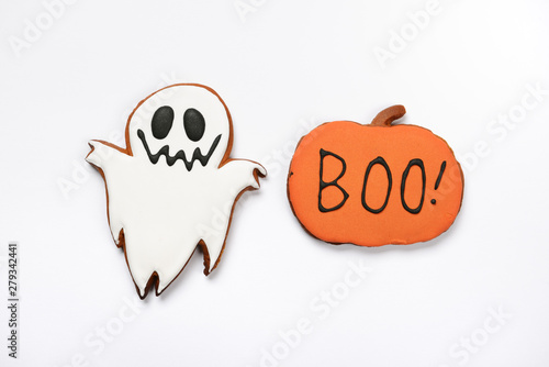 Fotografia, Obraz The hand-made eatable gingerbread Halloween ghost and pumpkin with boo inscripti