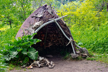 Reconstruction Of The Human Dwelling Of The Stone Bronze Age. Household Items. Archaeological Excavations Concept.