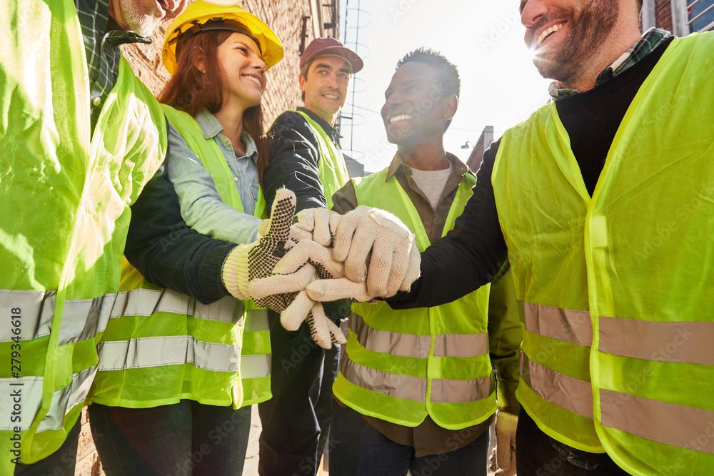 Fototapeta Group logistics worker stacks hands
