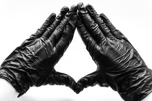 Female Hands In Black Gloves Show Gestures, Signs And Symbols Isolated On White Background. Two Hands With Fingers Folded In A Triangle