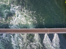 Aerial View Of Railway Bridge With One Track Across Rhine River In Switzerland.