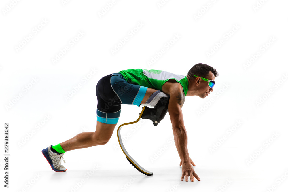 Fototapety, obrazy: Athlete with disabilities or amputee isolated on white studio background. Professional male runner with leg prosthesis training and practicing in studio. Disabled sport and healthy lifestyle concept.