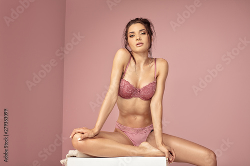 Obraz Sensual model in pink lingerie. - fototapety do salonu