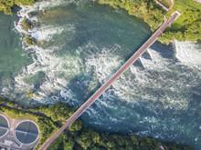 Aerial View Of Railway Bridge With One Track Across Rhine River In Switzerland.