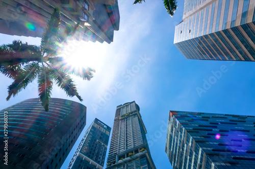 Obraz na plátně  Modern Office Skyscrapers and the Sun