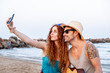Young couple make a selfie on a beach