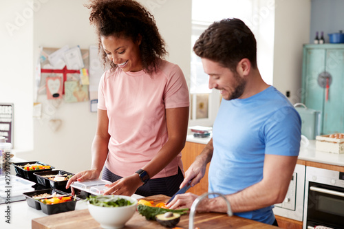 Photo Couple Preparing Batch Of Healthy Meals At Home In Kitchen Together