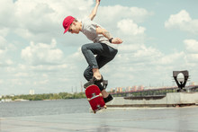 Skateboarder Doing A Trick At ...