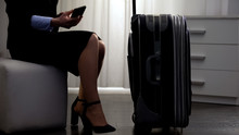Businesslady With Luggage Sitt...