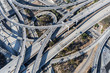 Aerial view of the Harbor 110 and Century 105 freeway interchange ramp bridges near downtown Los Angeles in Southern California.