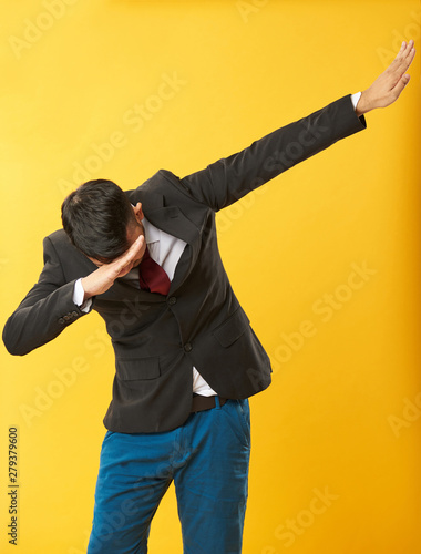 Asian guy doing dab - Buy this stock photo and explore similar