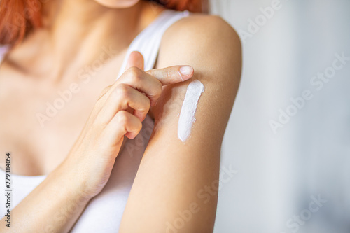 Obraz na plátně  Woman applying hand cream - stock photo