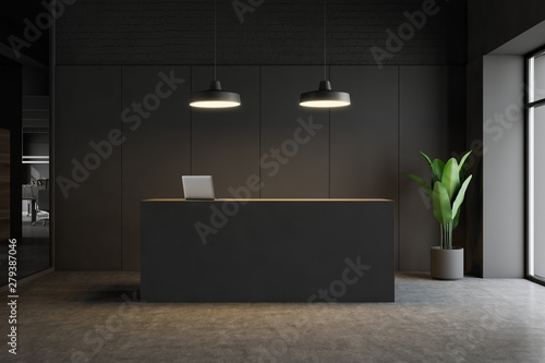 fototapeta na lodówkę Dark gray reception desk in modern office