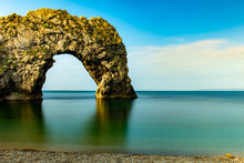Durdle Door Rock In Jurassic Coast In South England In A Long Exposure Shot With Nicely Blurred Calm Water In The Sea