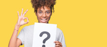 Young African American Woman Holding Paper With Question Mark Over Isolated Background Doing Ok Sign With Fingers, Excellent Symbol