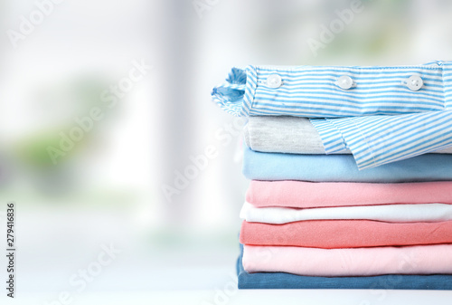 Colorful cotton stack pf clothing empty space background. Tableau sur Toile