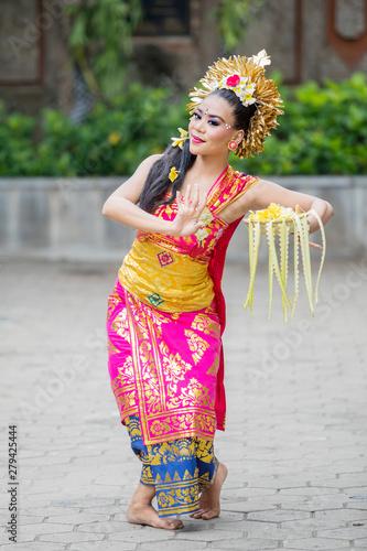 Balinese dancer dances with a bowl of flower petals Wallpaper Mural