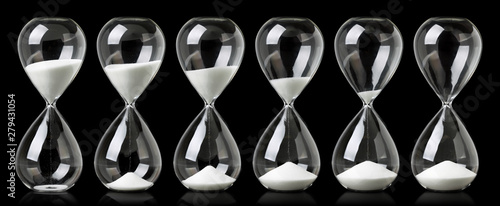 Cuadros en Lienzo Collection of hourglasses with white sand showing the passage of time