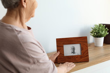 Elderly Woman With Framed Phot...