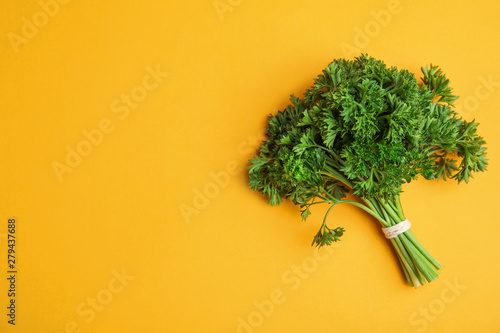 Fototapeta Bunch of fresh green parsley on orange background, top view. Space for text obraz