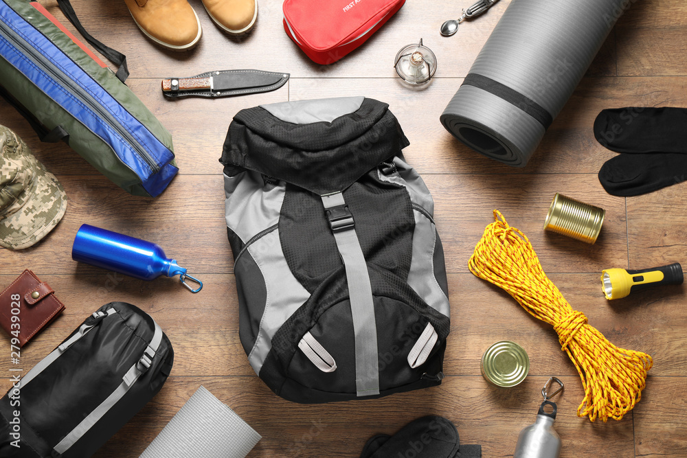 Fototapety, obrazy: Flat lay composition with different camping equipment on wooden background