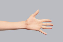 Young Woman Showing Hand On Grey Background, Closeup