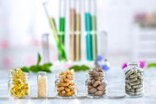 Herbal Medicine Pills With Dry Natural Herbs Concept Of Herbal Medicine And Dietary Supplements