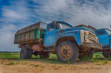Old Rusting Truck Or Lorry Outdoors In A Field