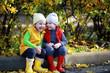 Leinwanddruck Bild Children walk in the autumn park