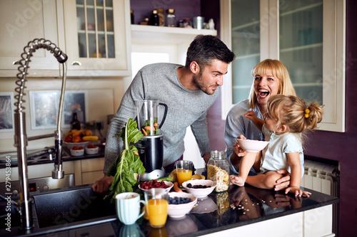 Fototapeta Family in kitchen having breakfast obraz