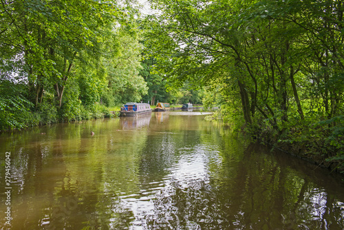Obraz Narrowboats on a British canal in rural setting - fototapety do salonu