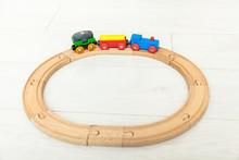 Child'd Wooden Train On The White Floor