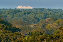 Green Tropic Jungle Forest With Big Cruise Chip On The Sea. Exotic Landscape  In Carara NP In Costa Rica. Big Boat In The Water, Sail Voyage Along The Ocean Cast. Travelling In Cantral America.
