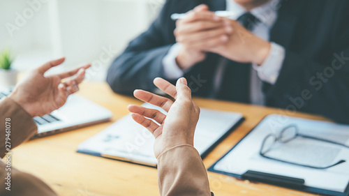 Attractive young business woman in a job interview with a corporate personnel manager