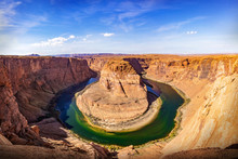 Horseshoe Bend Panorama View On A Sunny Day. The Most Famous Landscape At Glen Canyon Nation Park In Arizona, USA.