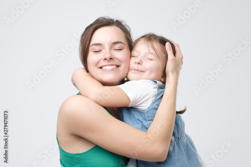 Woman hugging her cute child baby girl Canvas Print