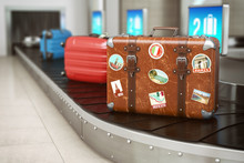 Old Vintage Suitcase On A Airport Luggage Conveyor Belt. Baggage Claim. Travel And Tourism Concept Background.