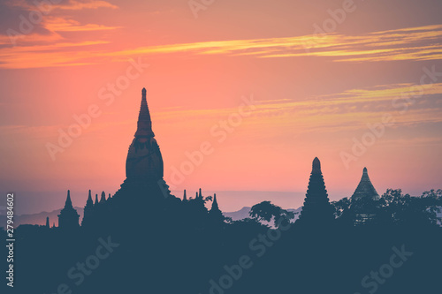 Amazing sunset colors and silhouettes of ancient Buddhist Temples at Bagan Kingdom, Myanmar (Burma) Wallpaper Mural