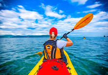 Lady Paddling The Kayak In The Avacha Bay