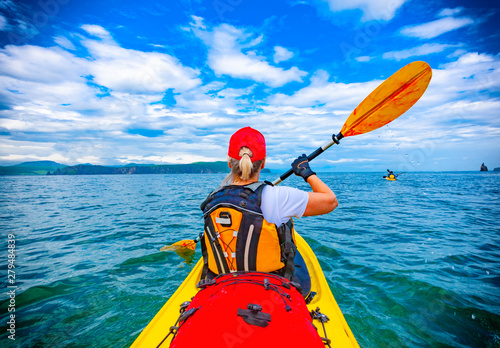 Lady paddling the kayak in the Avacha bay Canvas-taulu