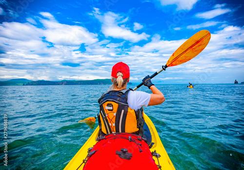 Valokuva  Lady paddling the kayak in the Avacha bay