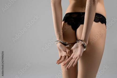 Fototapeta  Slim girl in lace lingerie cropped rearview