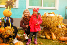 Cute Little Girl With Mom In A Pumpkin Patch, Autumn Fair