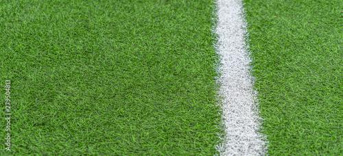 Foto op Plexiglas Groene Green artificial grass soccer sports field with white stripe line