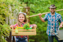 She Knows Everything About Flowers. Spring Village Country. Father And Daughter On Ranch. Little Girl And Happy Man Dad. Earth Day. Ecology. Gardening Tools. Family Farm