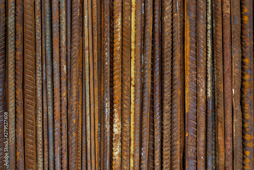 Valokuva  Top view stack of straight old rusty high yield stress deformed reinforcement steel or iron bars