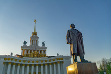 Soviet Communist Leader Vladimir Lenin Statue In Front Of Old Building At VDNH In Moscow