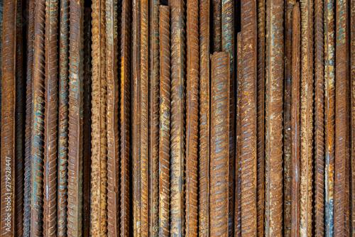 Fényképezés  Top view stack of straight old rusty high yield stress deformed reinforcement steel or iron bars